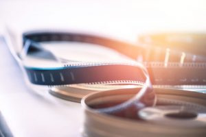 Cinema film reel or filmstrip, close up picture. By Patrick Daxenbichler